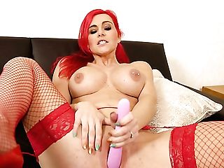 Bright Ginger Nymphomaniac In Crimson Fishnet Stockings Roxi Keogh Masturbates With Tool